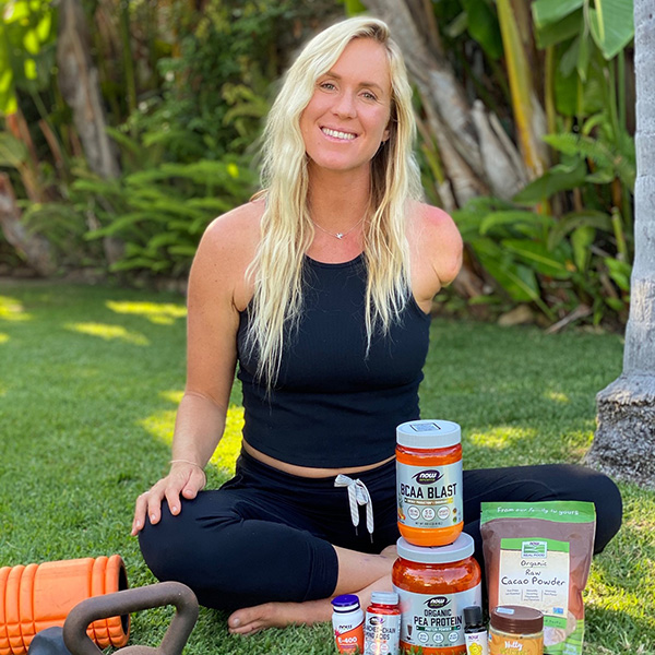 bethany hamilton  poses with now products