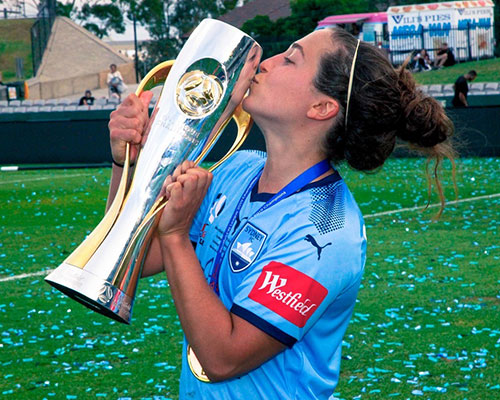 danny c kisses trophy soccer