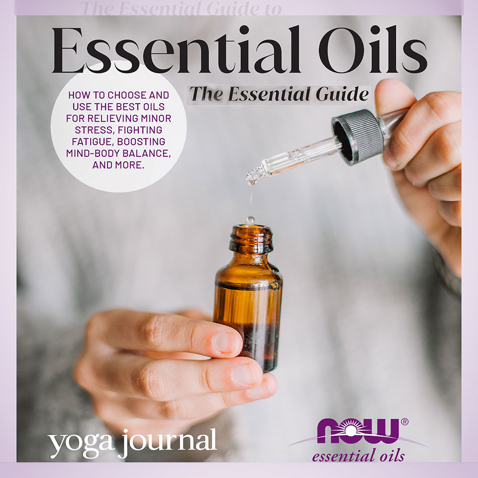 person using dropper top from essential oil bottle
