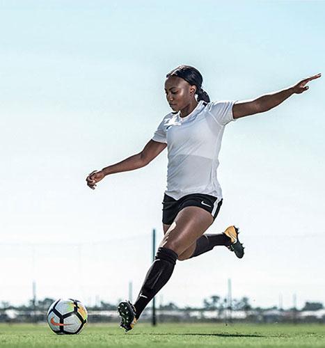 jamia fields ambassador soccer action image