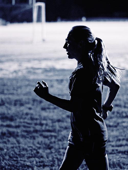 natalie larson running at night - black and white photo