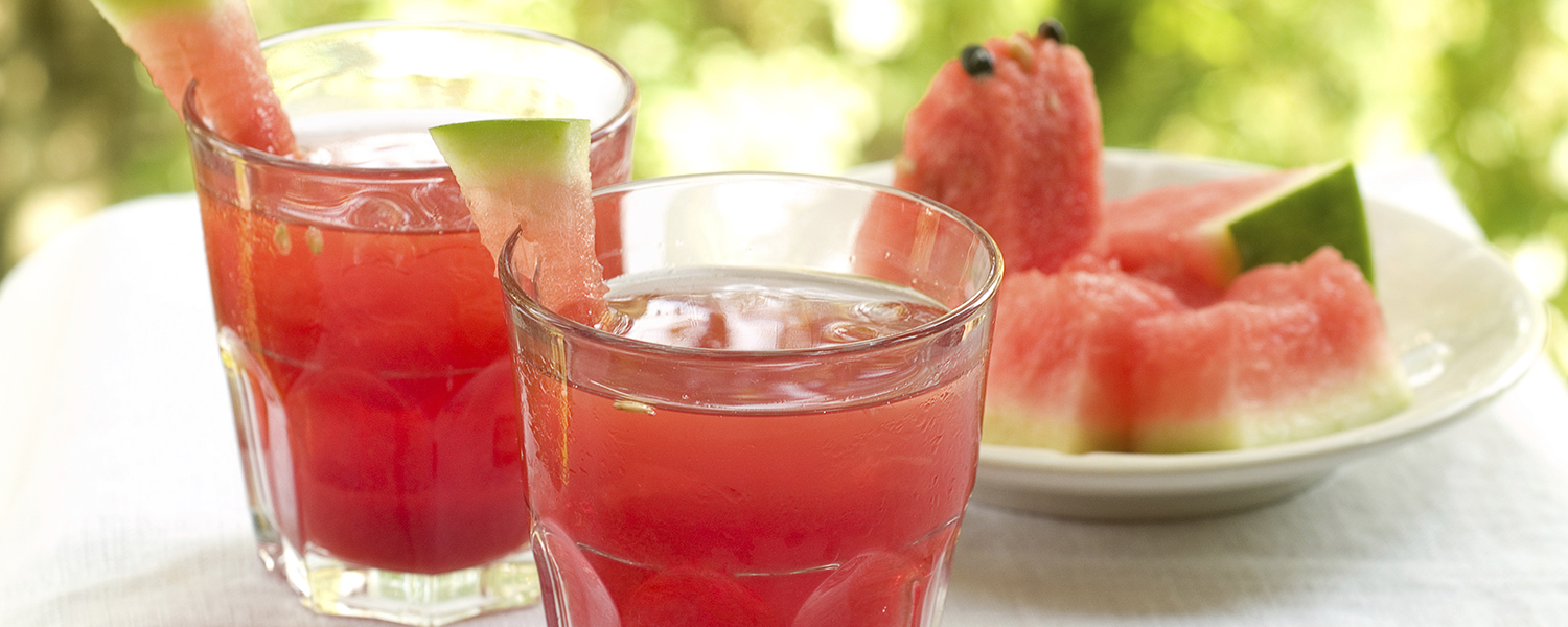 Two drink glasses are filled with Righteous Raspberry Watermelon Cooler.